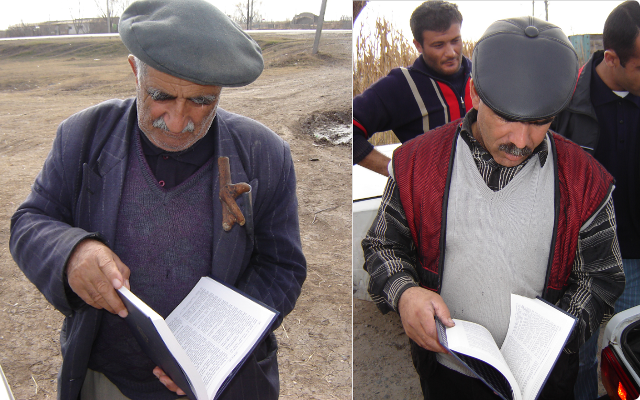 Azeri men browsing through a Bible.